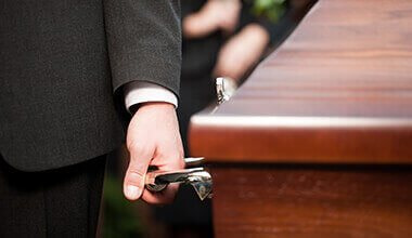 pallbearers at a funeral for a wrongful death