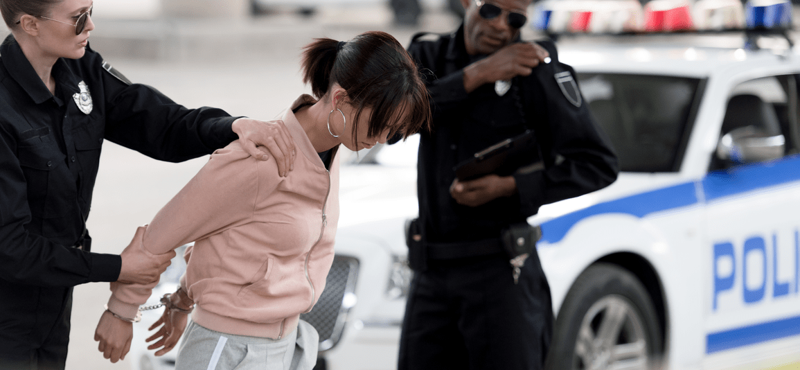 woman being arrested for prostitution charges