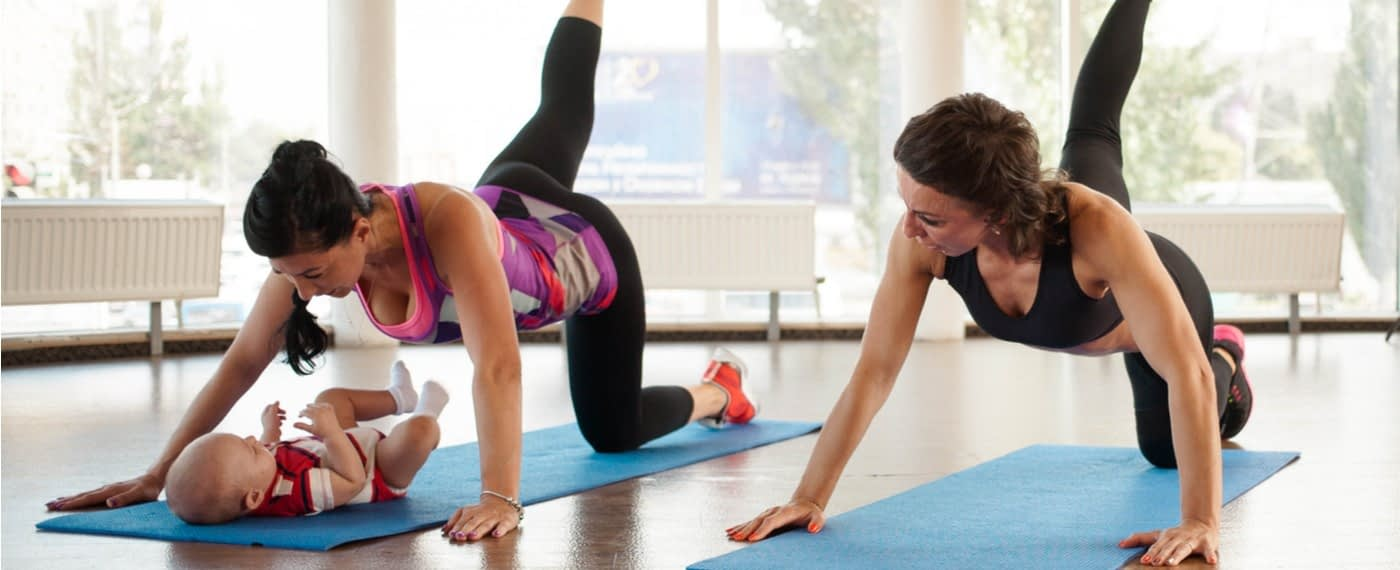 woman with baby performing yoga for ost pregnancy workout plan