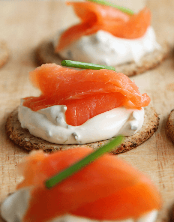Smoked salmon and cream cheese on a cracker