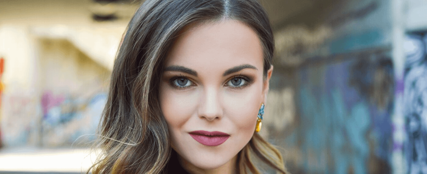 Woman with full eyebrows looking straight at camera