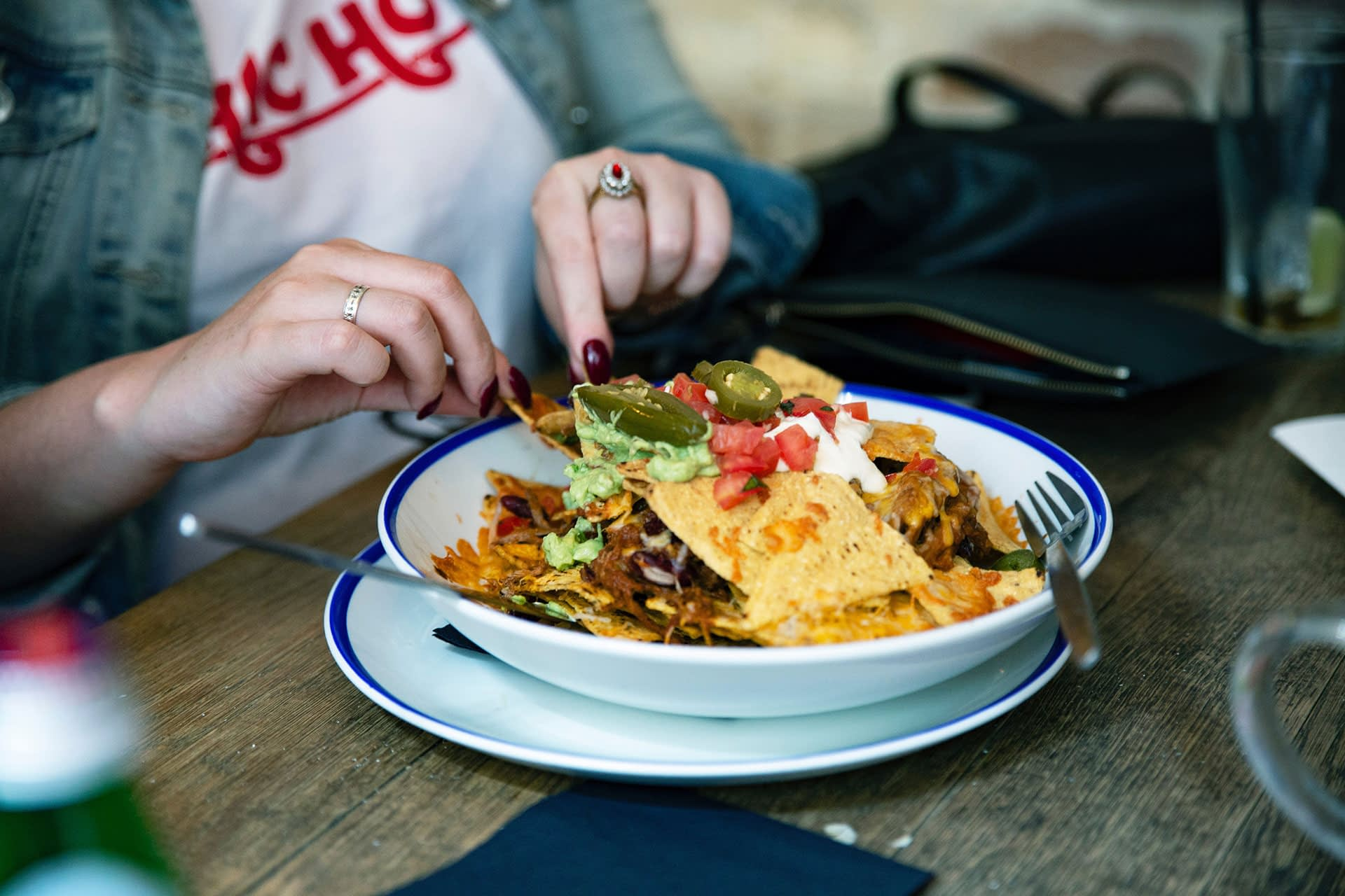 woman eating chicken nachos with cheese as an easy microwave meal