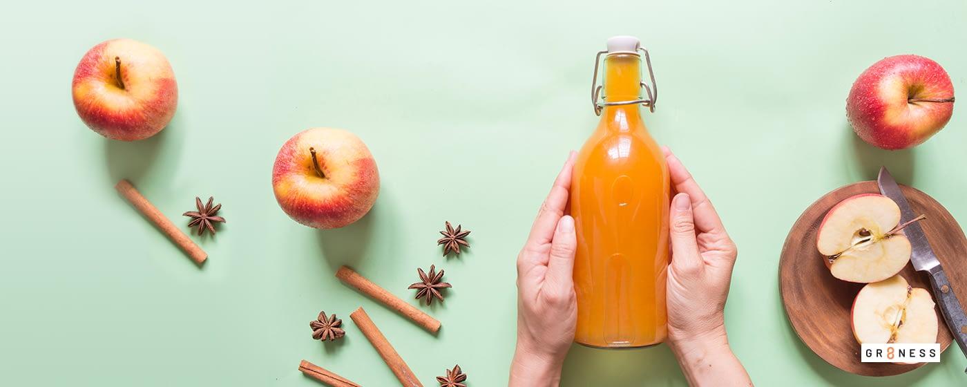 A glass bottle of apple cider vinegar