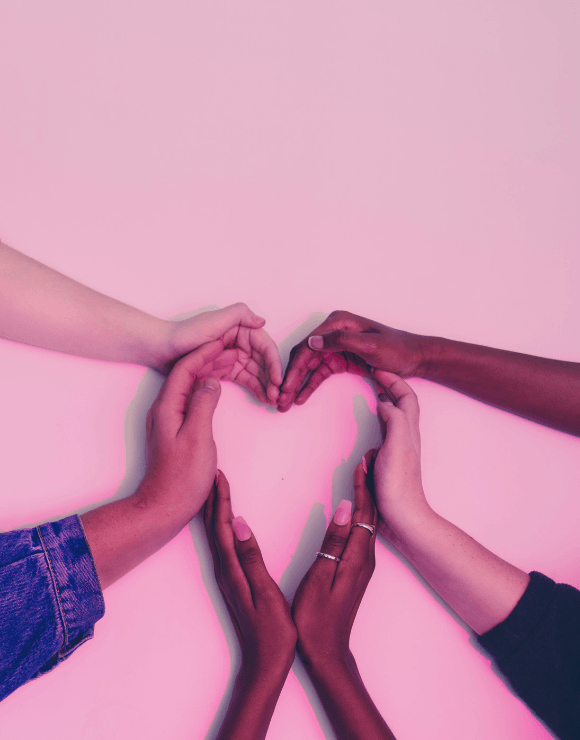 Five different hands forming the shape of a heart