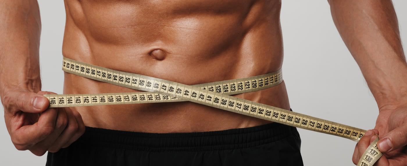 Man measuring waist with measuring tape