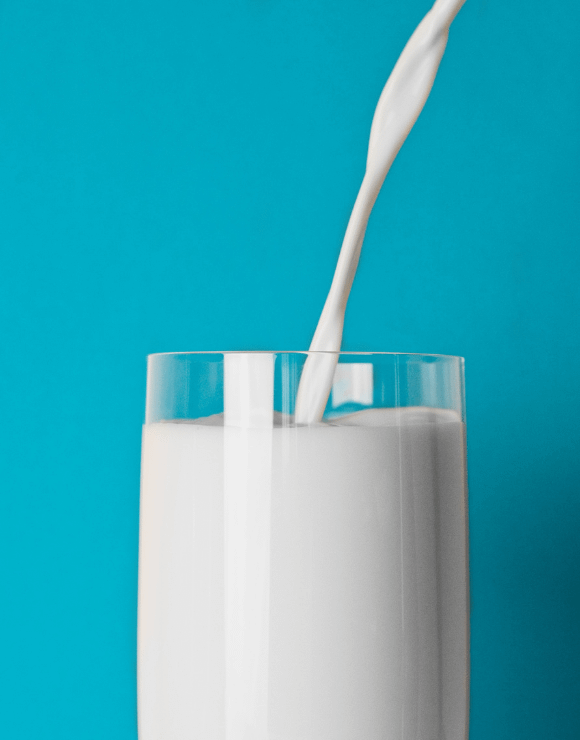 Milk being poured smoothly into a glass