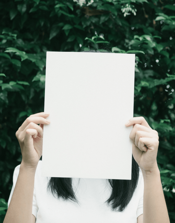 Girl holding a single piece of paper to help promote paper consumption