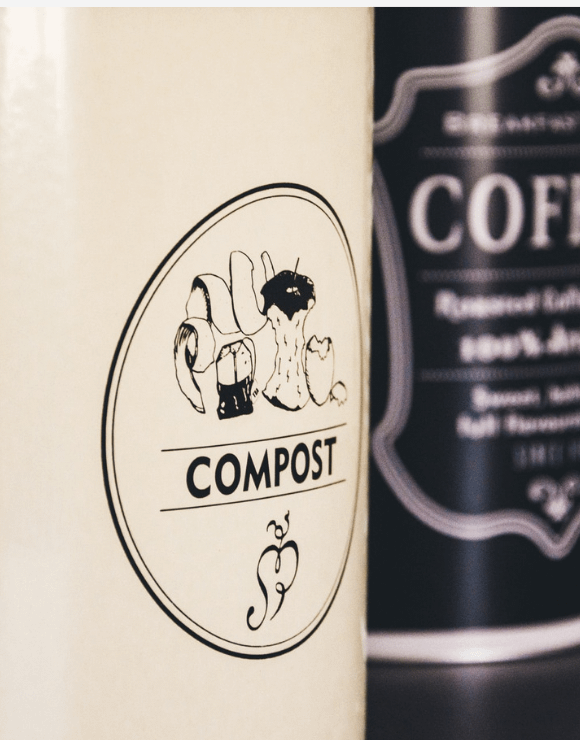 Close up of a compost sticker to help promote environmental awareness