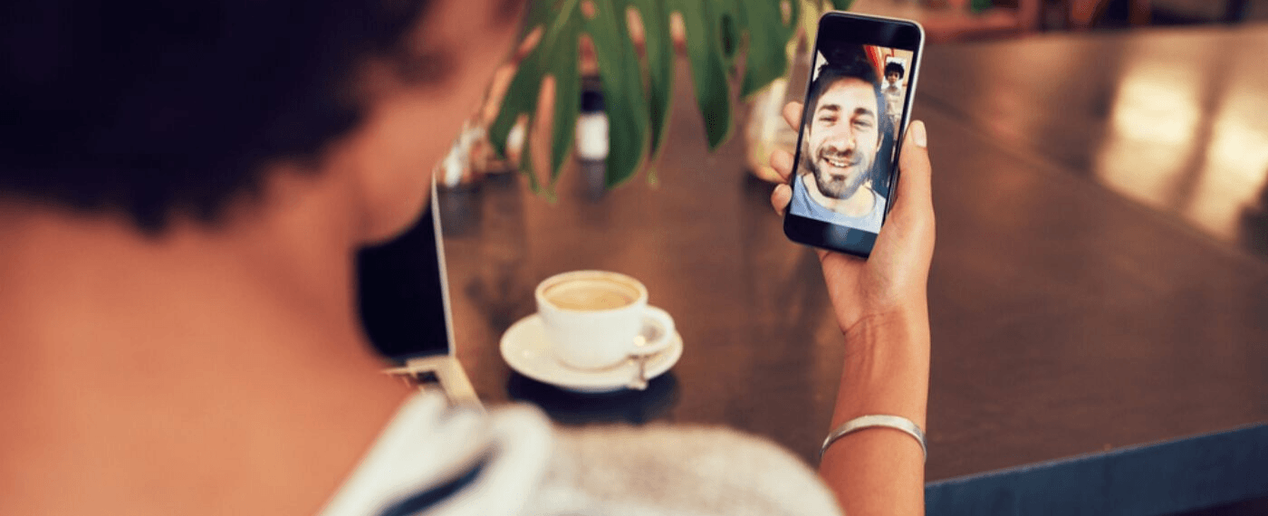 couple in long distance relationship face timing each other