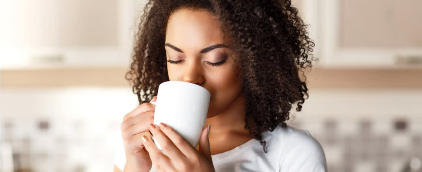 A woman enjoying a cup of tea