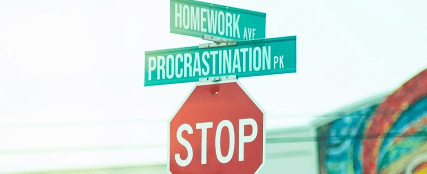 A stop sign with Homework Ave and Procrastination Park road signs in top