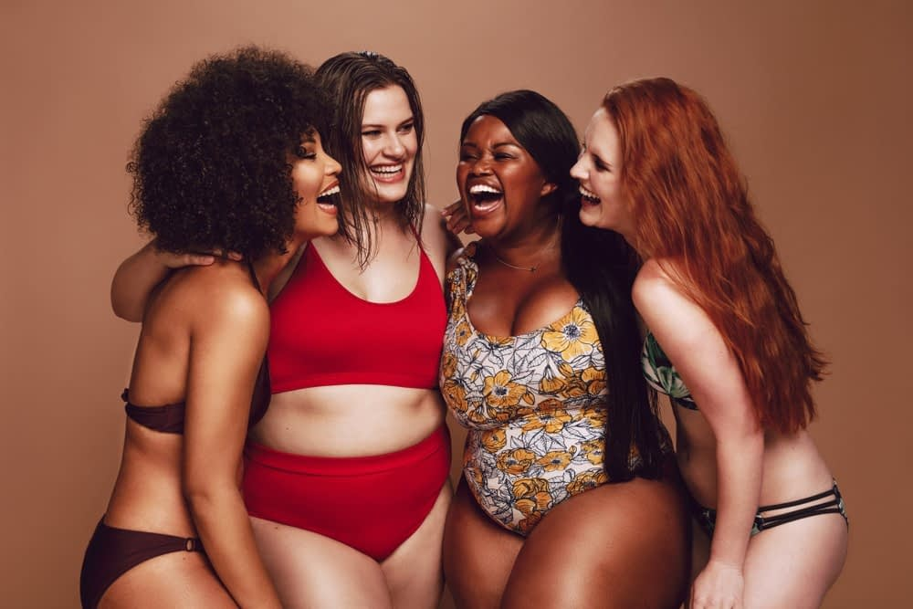 woman of different body types laughing together while discussing the best diet for their body type