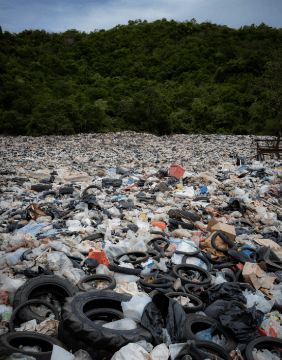 A large field fully covered in piles of trash