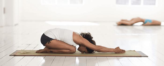 woman on yoga practicing yoga poses to help sleep better