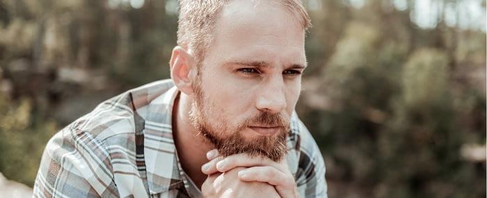 Blonde bearded man thinking hard