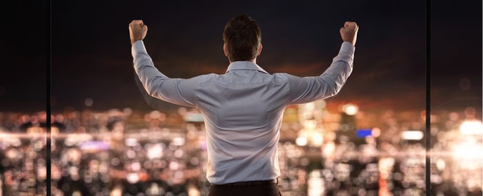 business man with his arms in the air for daily affirmations