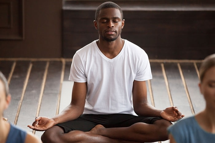 man practicing meditation using a meditation app