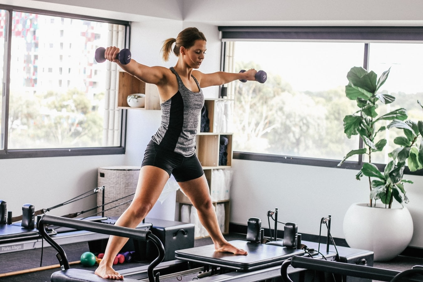 woman using trendy fitness equipment in her home