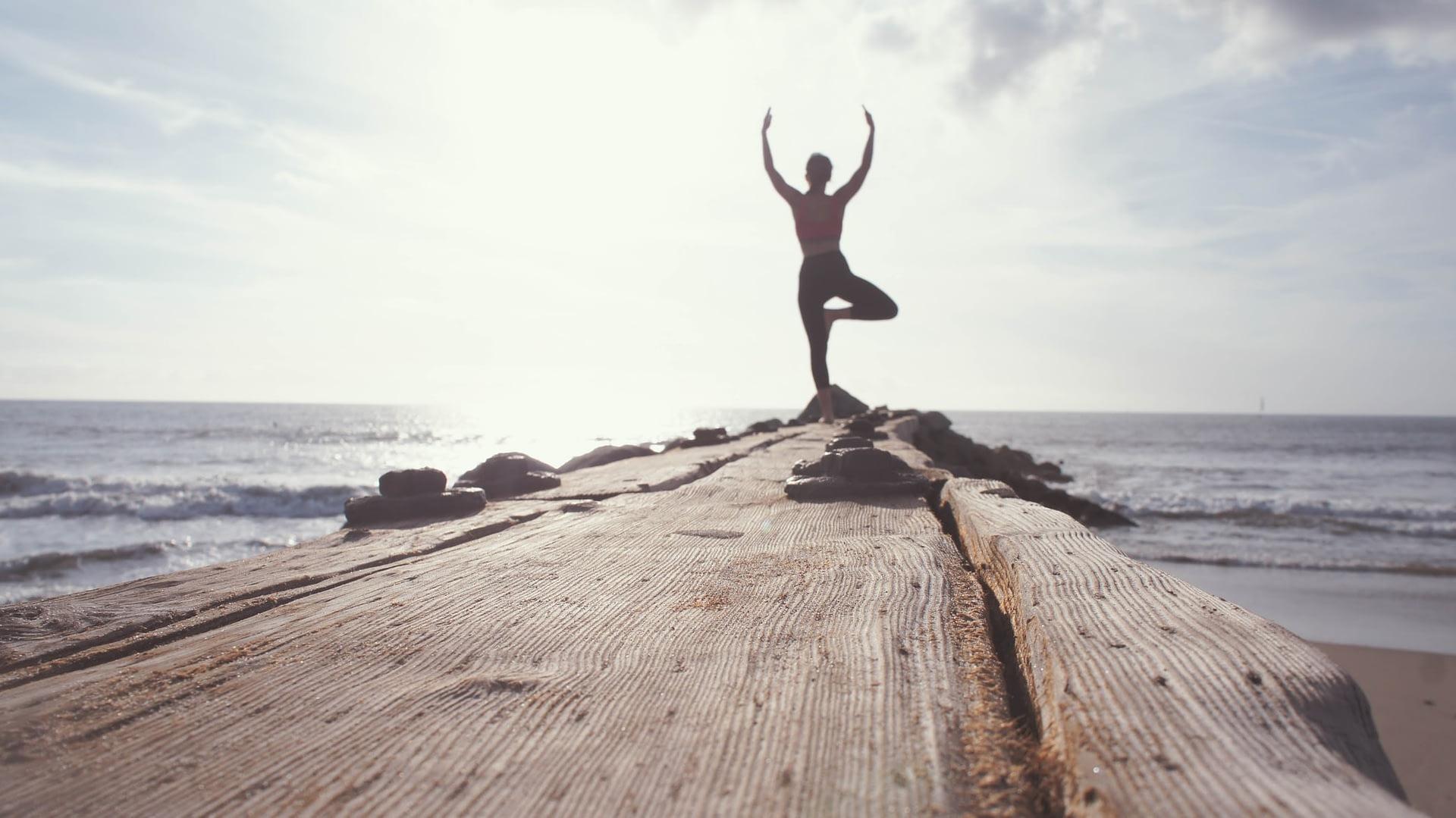 A woman performing morning yoga poses
