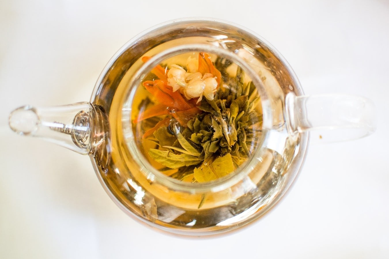 clear teapot filled with tea water