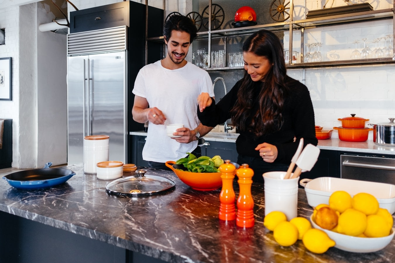 couple making meal together as part of weight loss habits