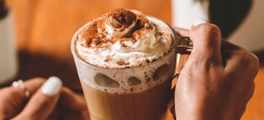 Pumpkin spice latte with whip cream, cinnamon, and CBD