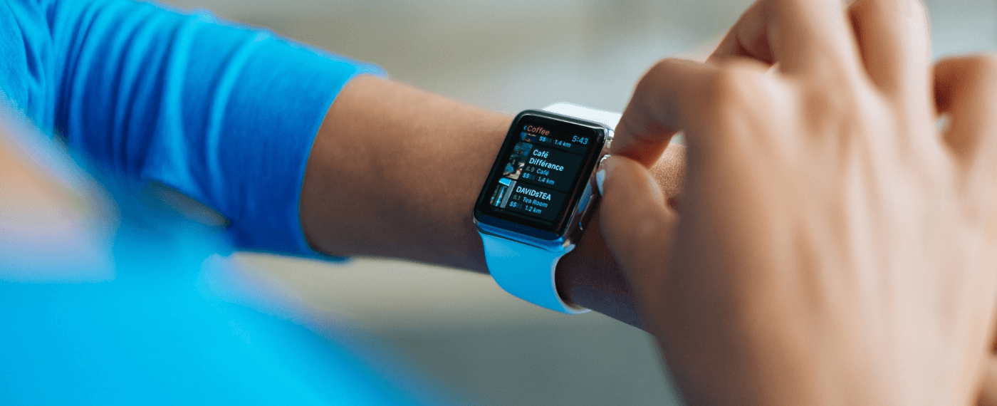 A smart watch displaying a fitness app