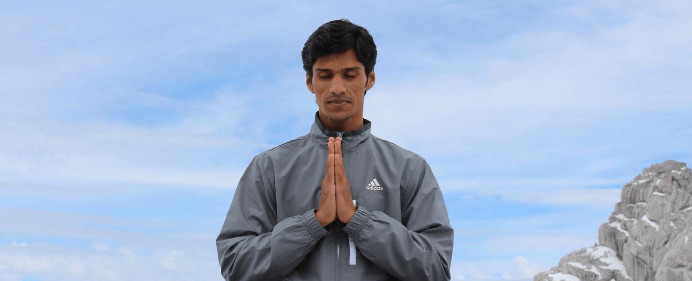 man meditating on a rock practicing yoga 101