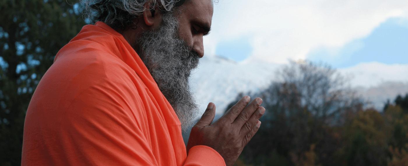 older man meditating to the meaning of namaste