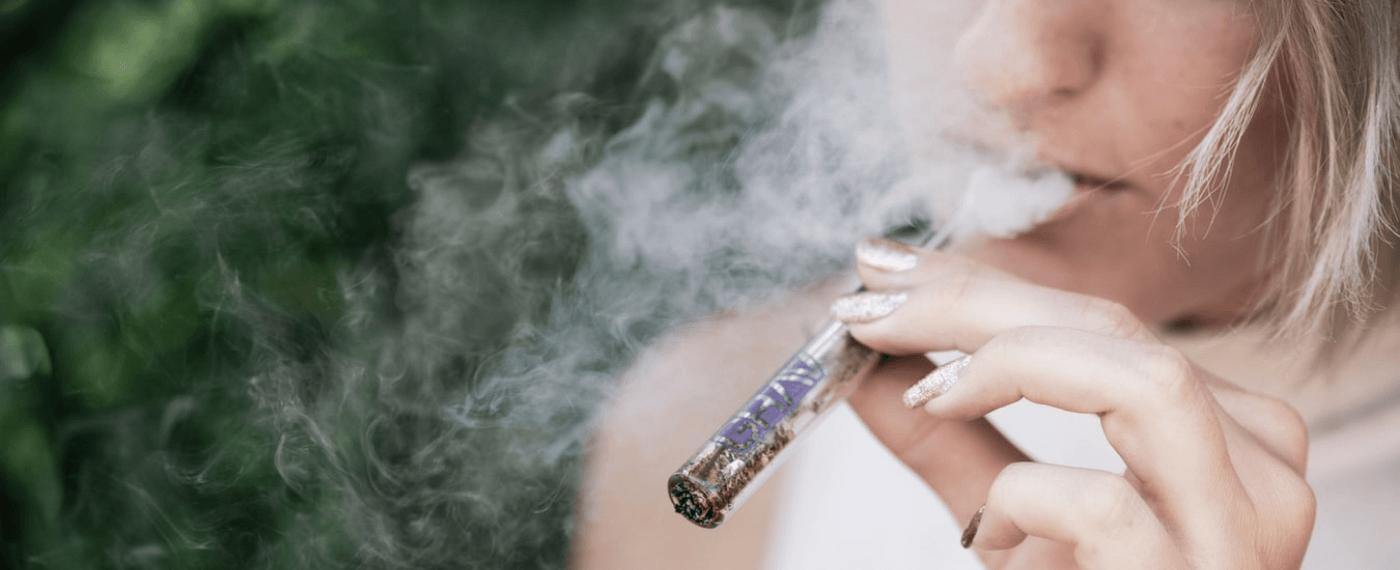Girl smoking cbd for pain relief