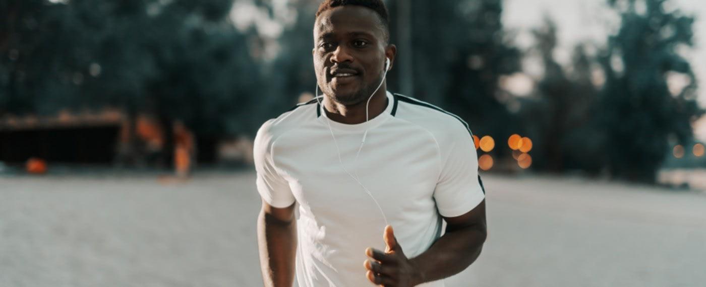 man running with headphones listening to wright loss motivation