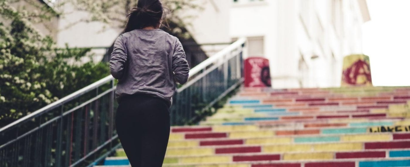 girl running up stairs to promote exercise and eating healthy