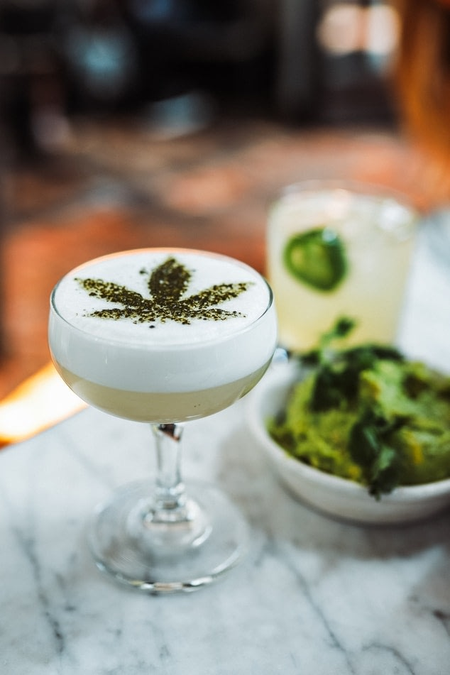 A martini glass filled with a CBD cocktail