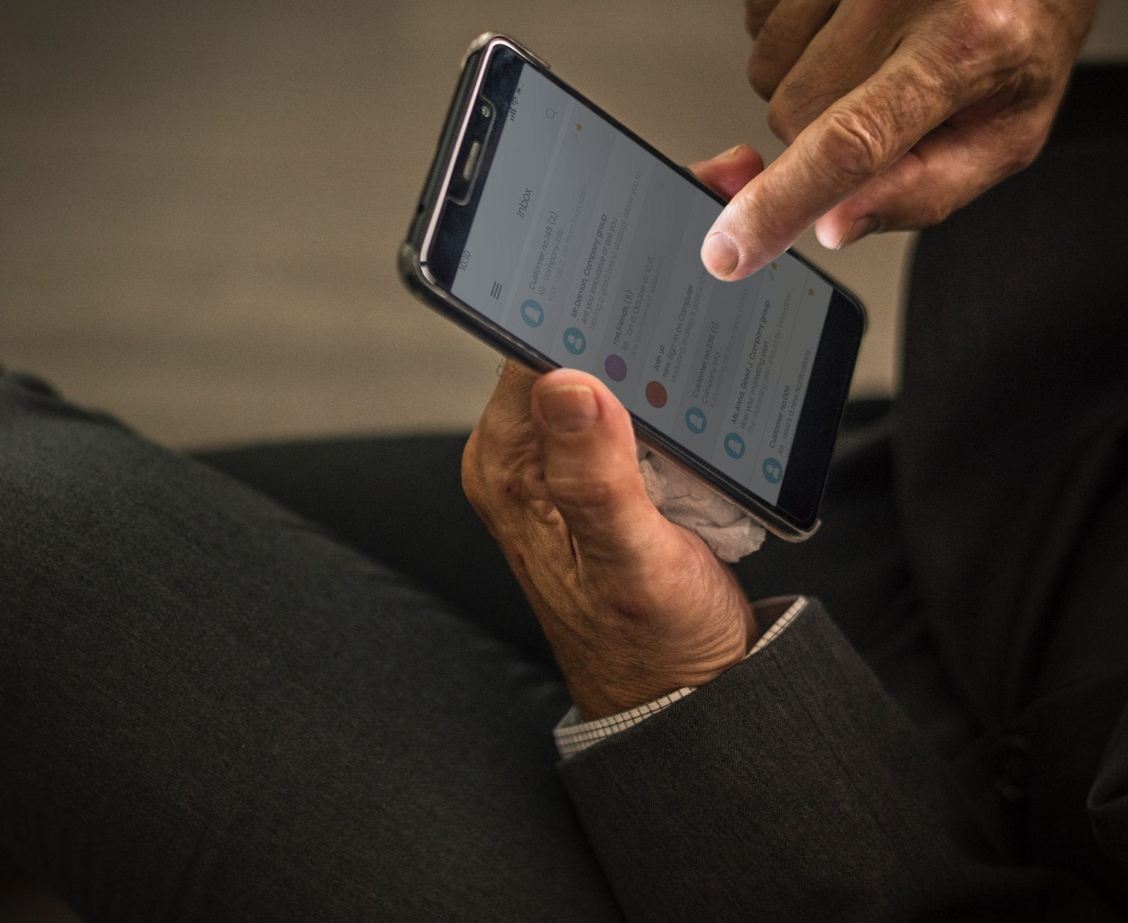 Man checking emails on smartphone