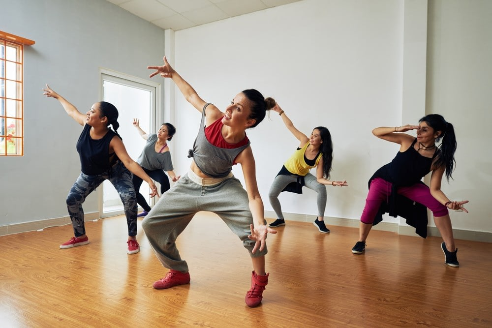 Group of women practicing hip hop dancing to stay fit