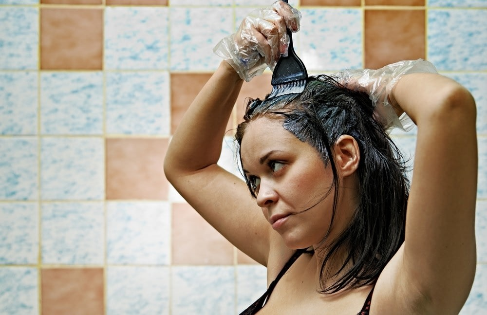 Woman using henna to dye her hair