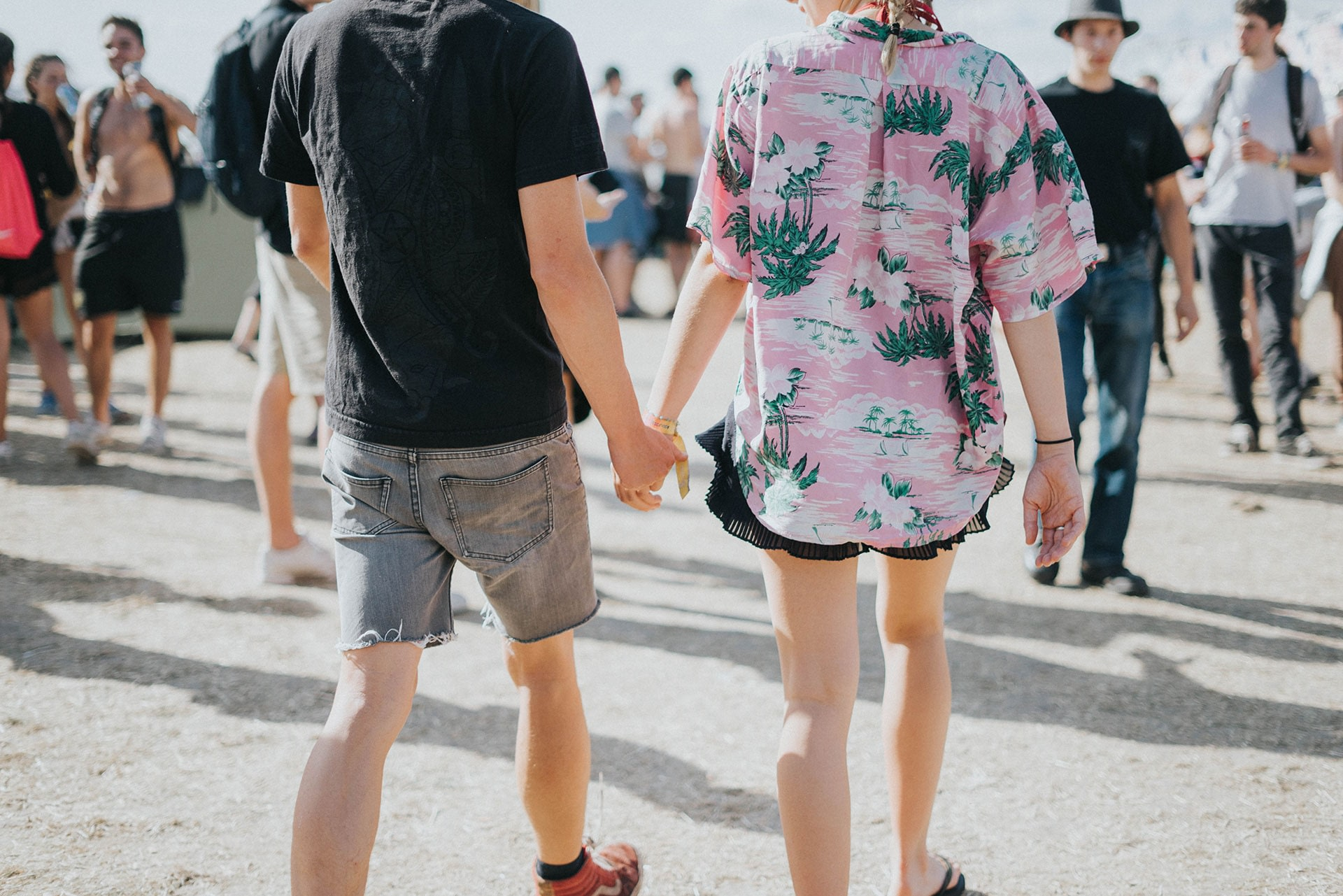 Partners holding hands in a crowd as part of their love style