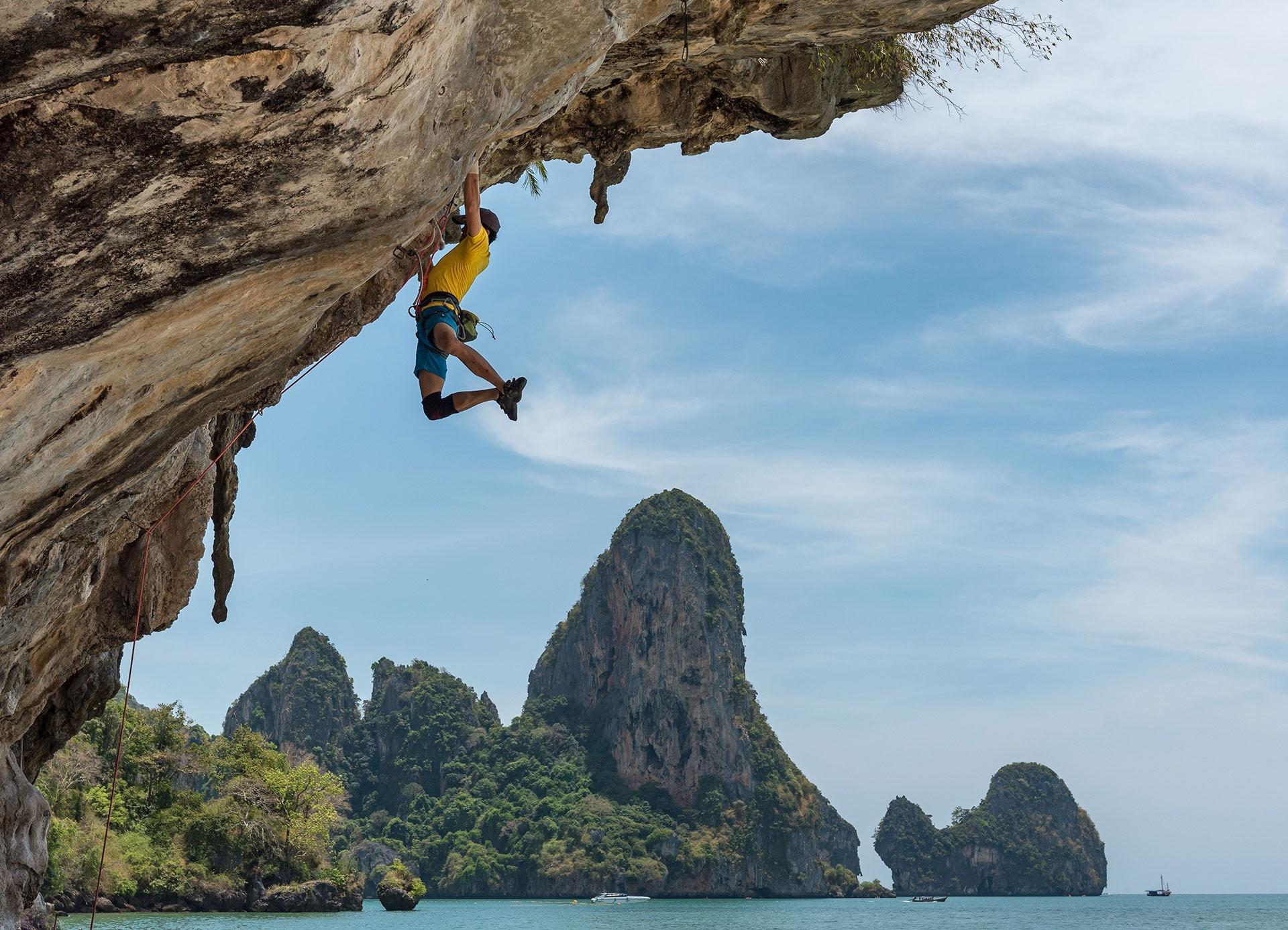 Man using motivation habits to help overcome rock climbing