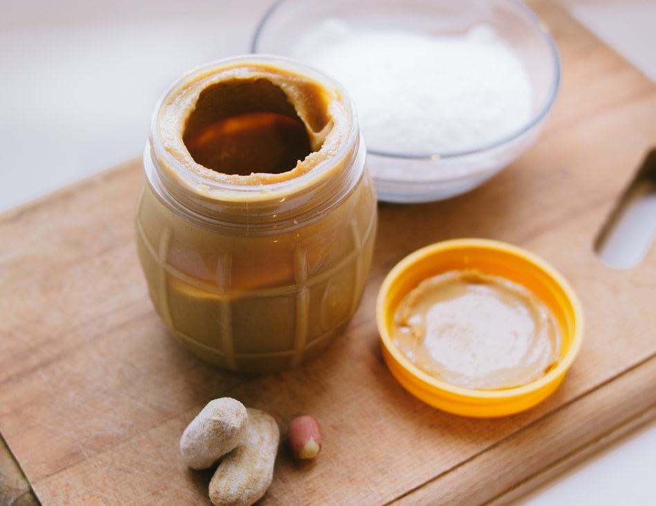 A peanut shaped jar of peanut butter