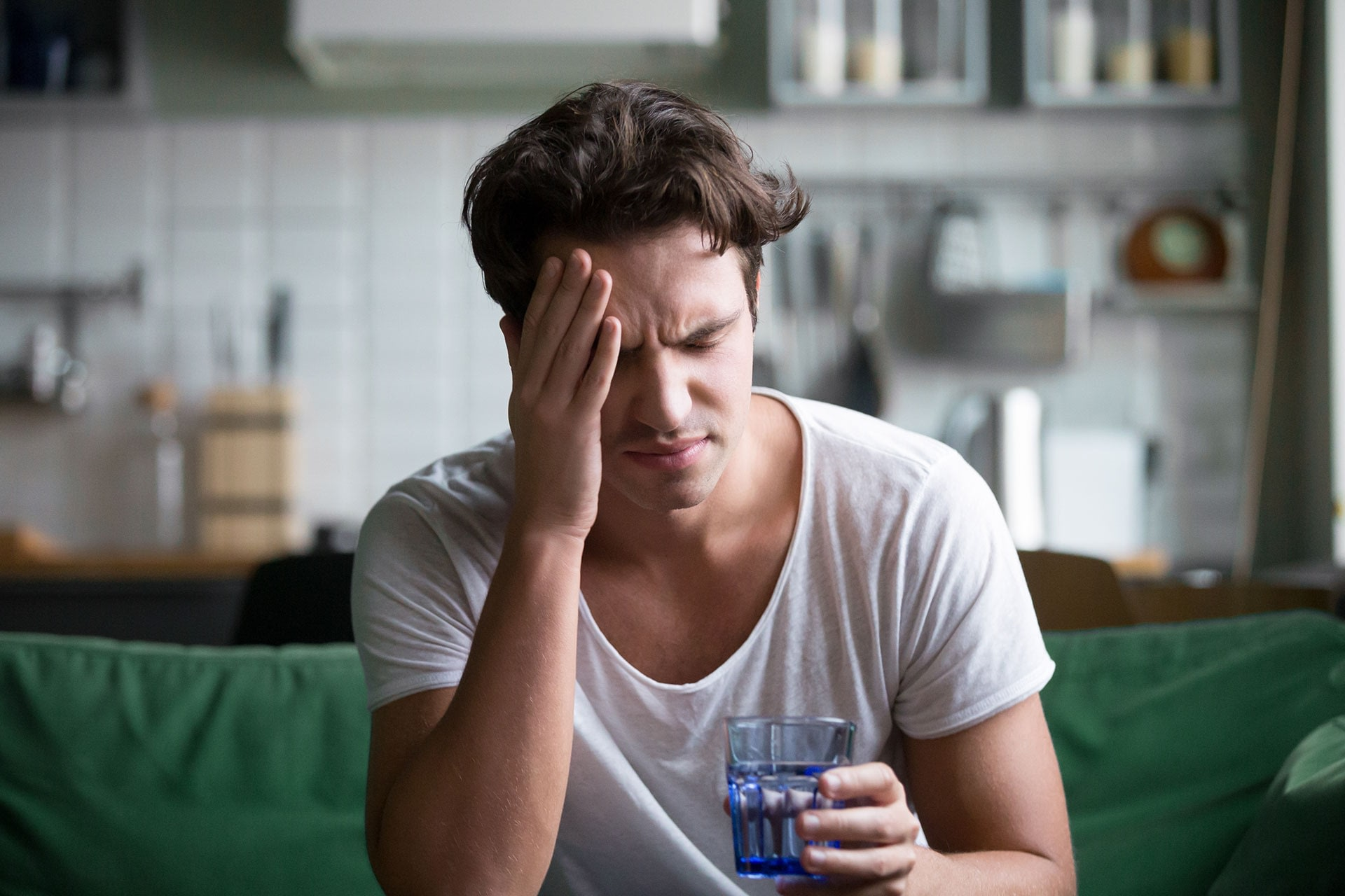 man with headache in need of migraine pain remedies