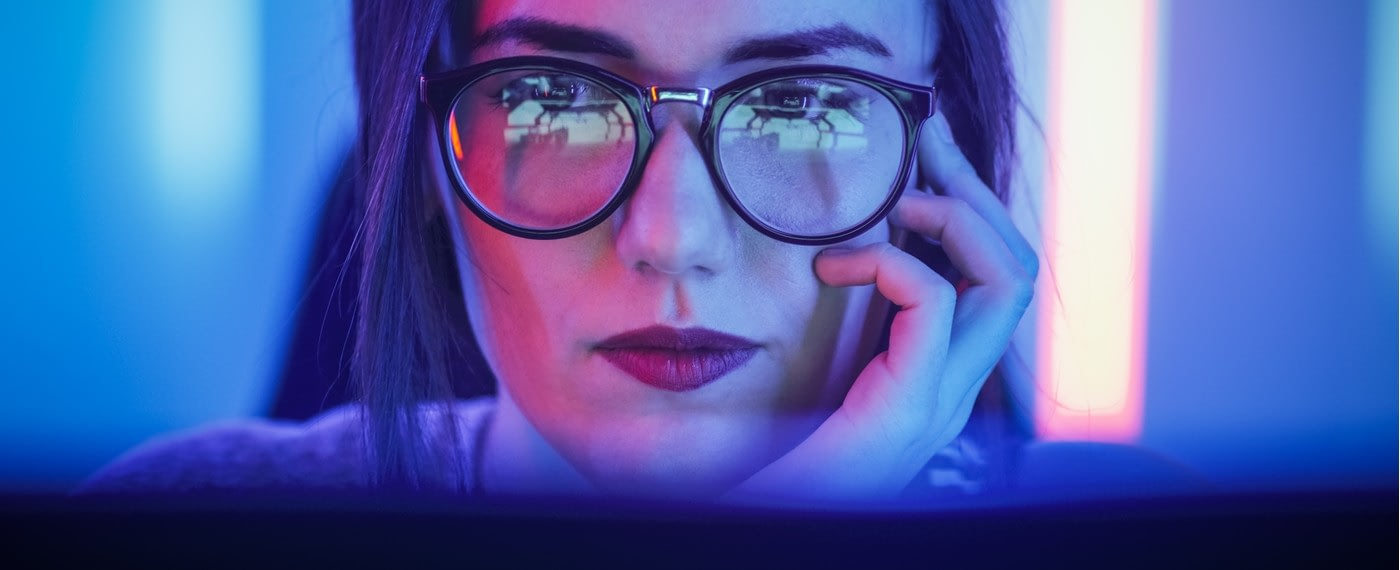 Woman with glasses researching cbd products online