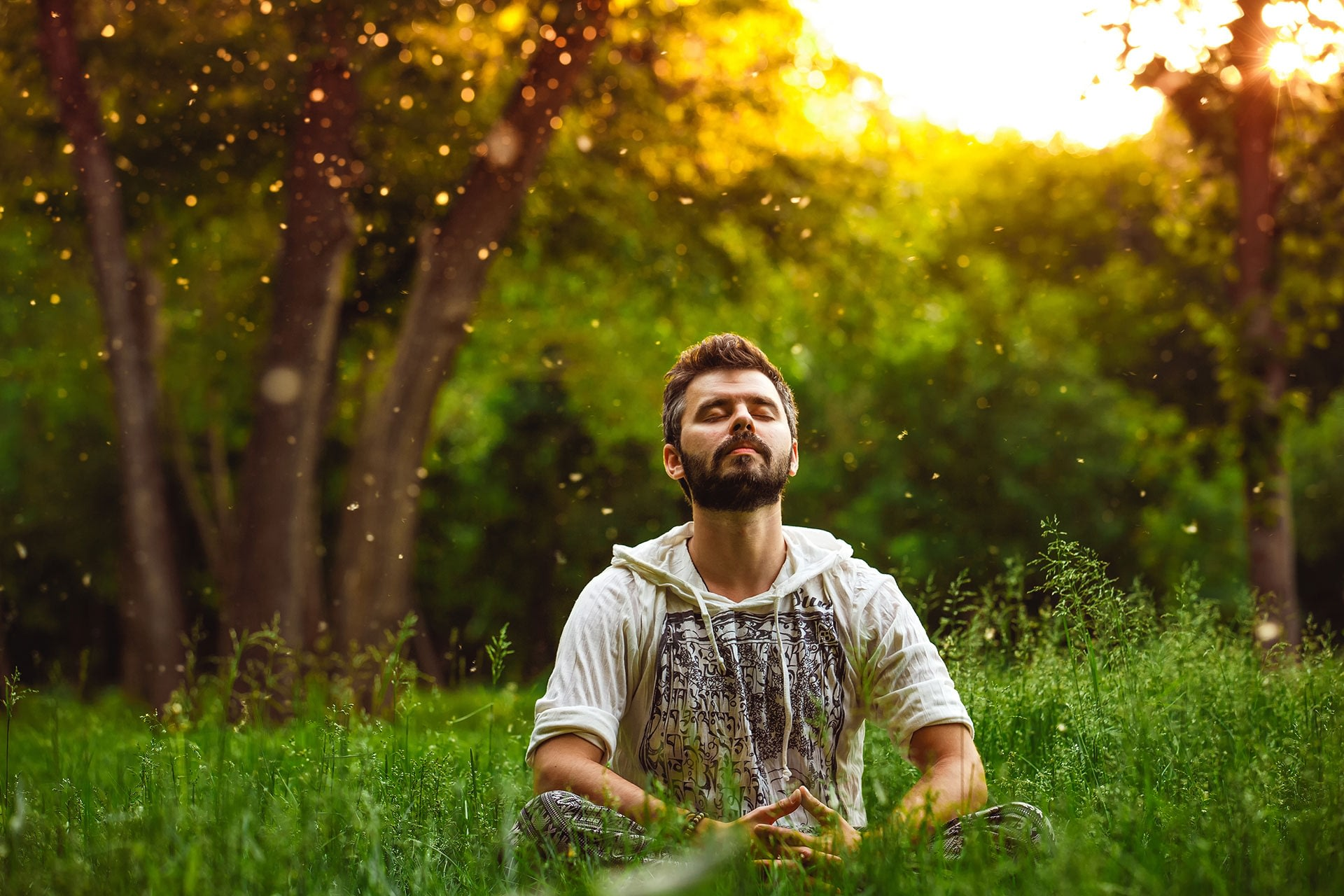 A man sits in serene nature practicing meditation
