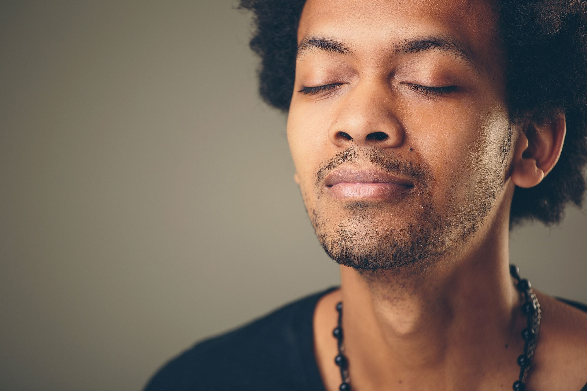 man practicing mindful breathing