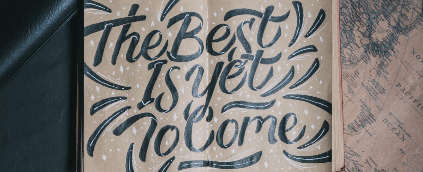 Handwritten text saying the best is yet to come