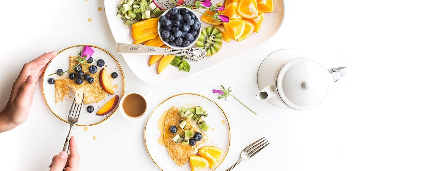 Healthy pancakes with fresh fruit and coffee