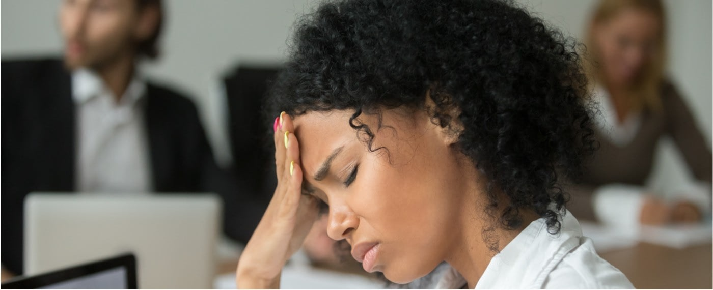 a woman experiencing the physical effects of stress