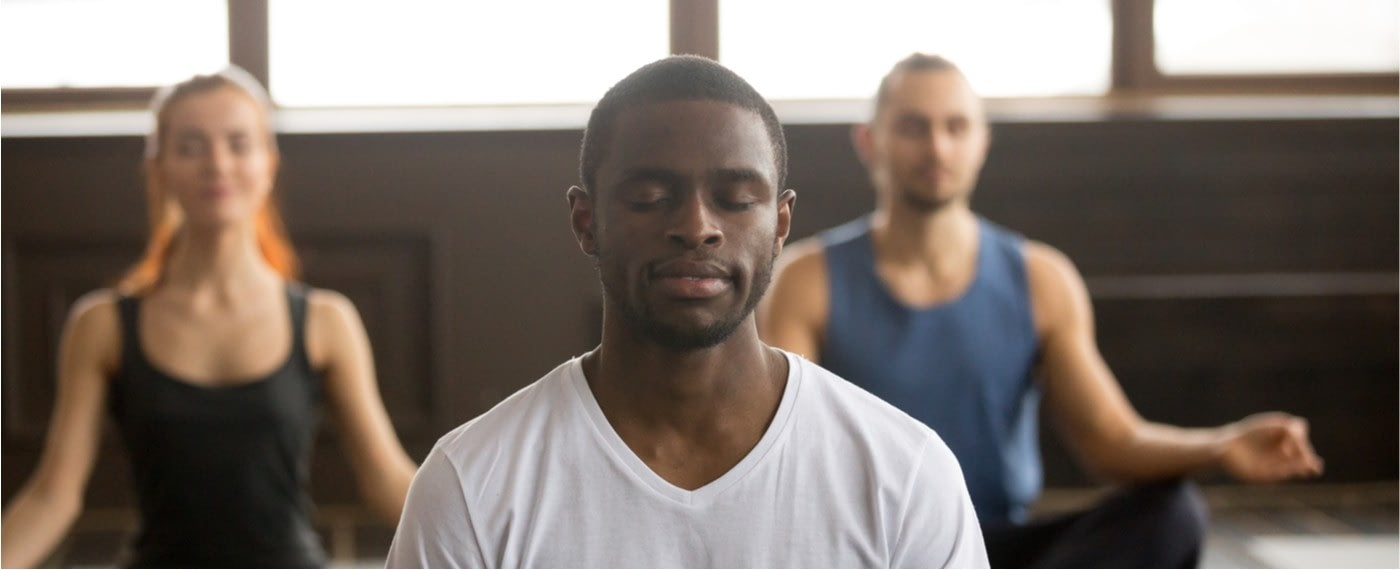 Man relaxing his mind while meditating