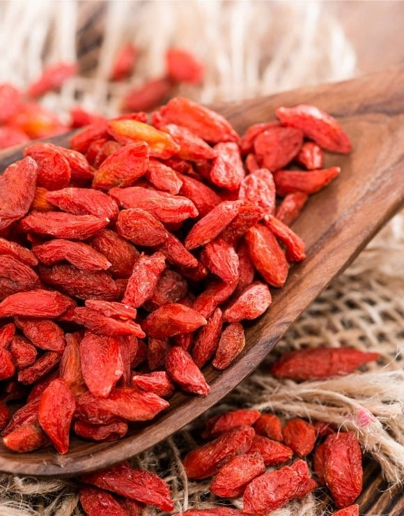 A large wooden spoonful of Goji Berries