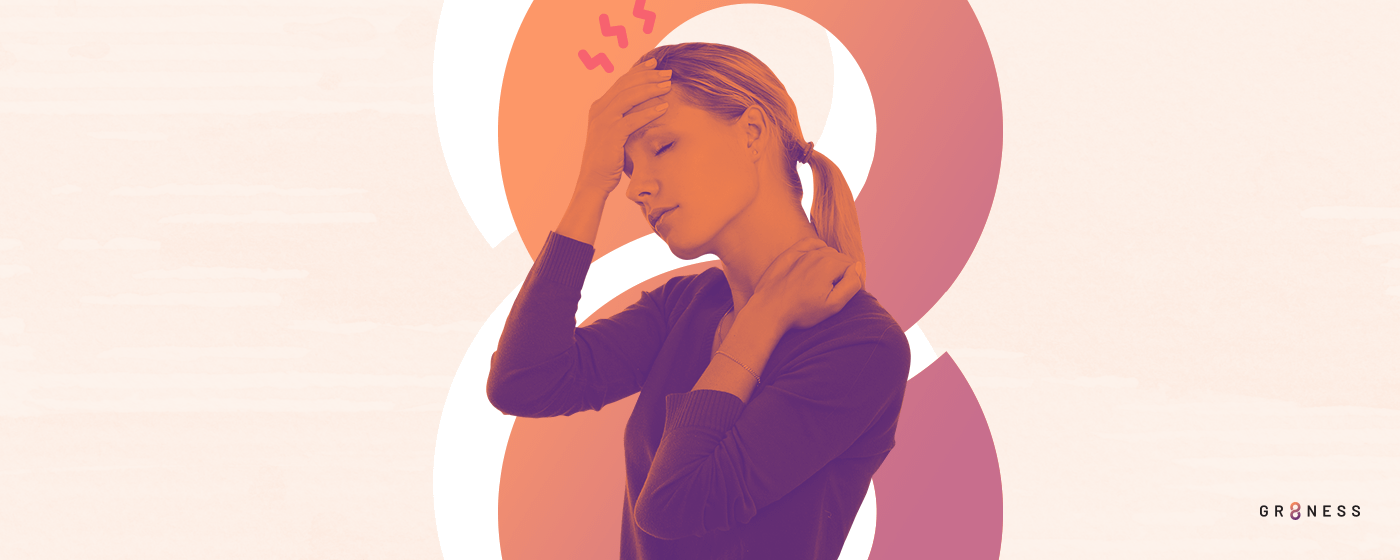 A woman suffers from a headache needing natural relief