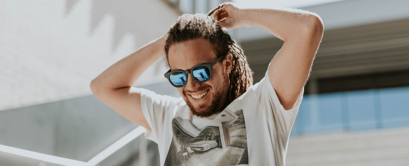 A man with dreadlocks consciously practices self-care